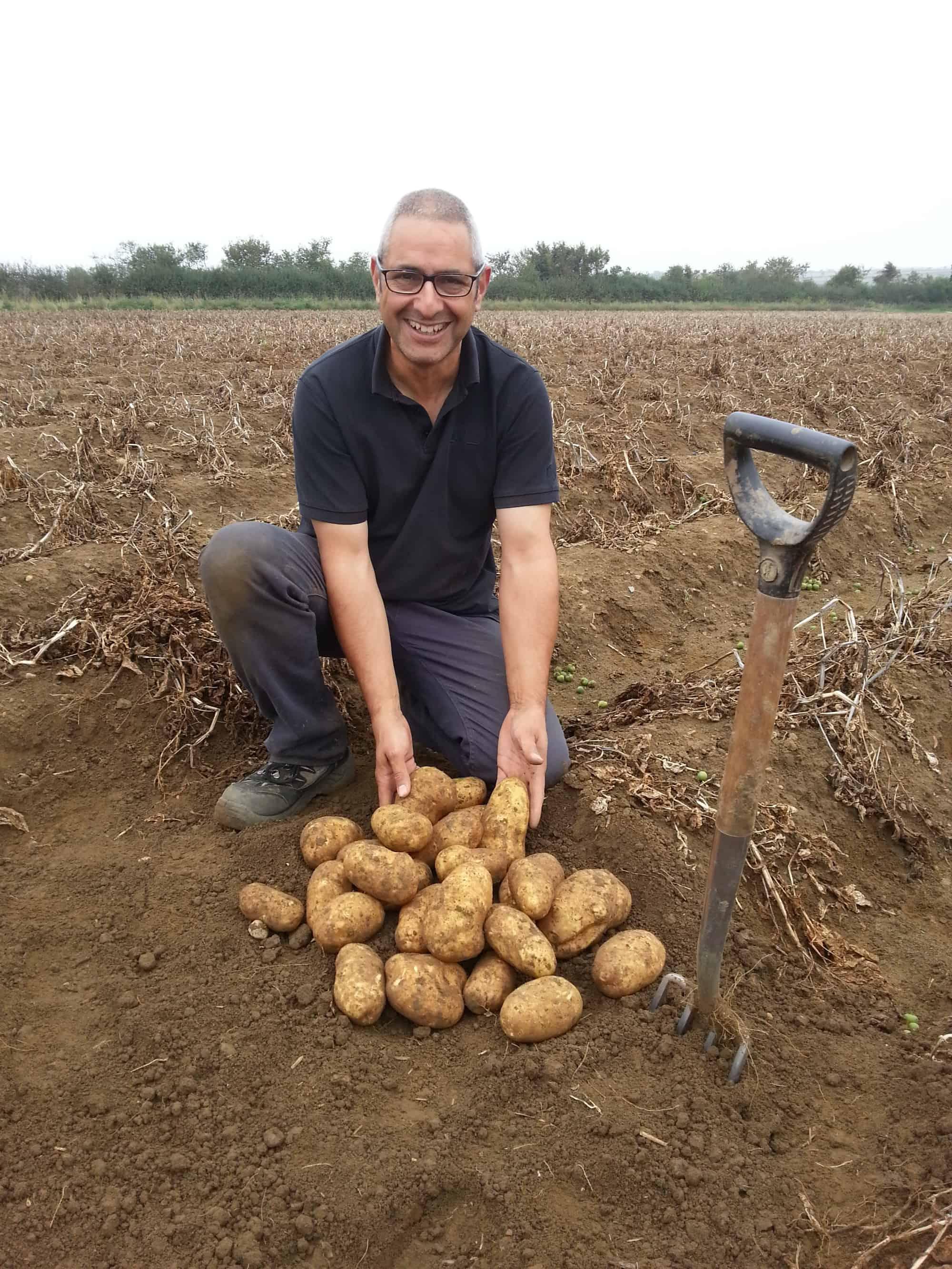 John Saurp in a potato field